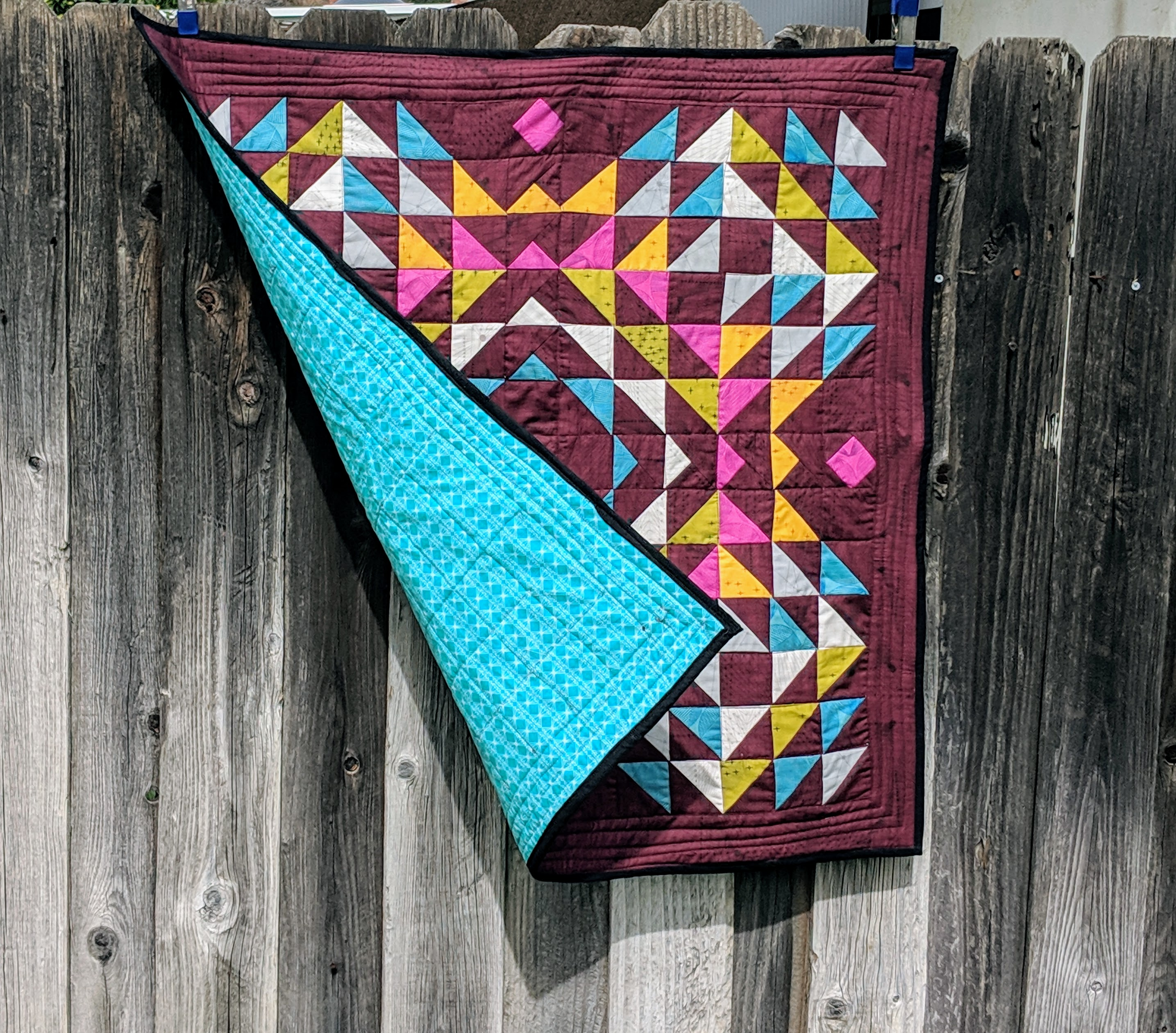 Totality Quilt Pattern featuring Quantum by Giucy_Giuce . I adore how these half square triangles are laid out #quilts #patchworkquilts #modernquilts